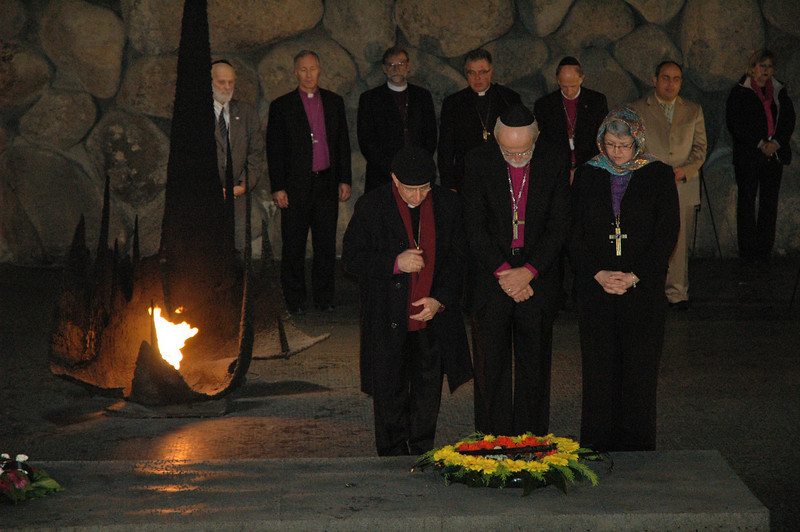 From left, ELCJHL Bishop Munib Younan, ELCA Presiding Bishop Mark Hanson and ELCIC National Bishop Susan Johnson lay a wreath Jan. 8 at Yad Vashem, Jerusalem, a Holocaust memorial.