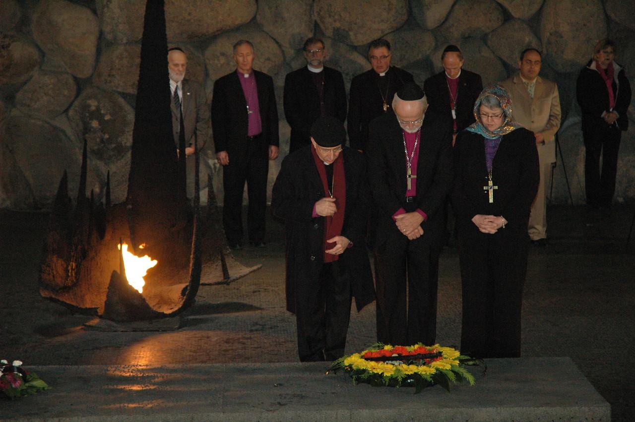 From left, ELCJHL Bishop Munib Younan, ELCA Presiding Bishop Mark Hanson and ELCIC National Bishop Susan Johnson lay a wreath Jan. 8 at Yad Vashem, Jerusalem, a Holocaust memorial.