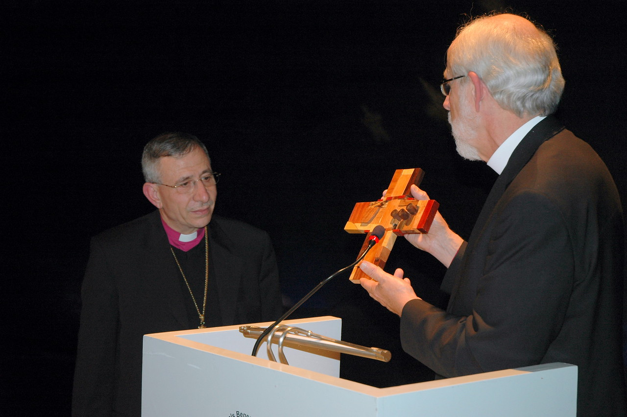 ELCA Presiding Bishop Mark Hanson, right, gives a gift on behalf of the North American Lutheran bishops, to ELCJHL Bishop Munib Younan, Jan. 10 in Bethlehem.