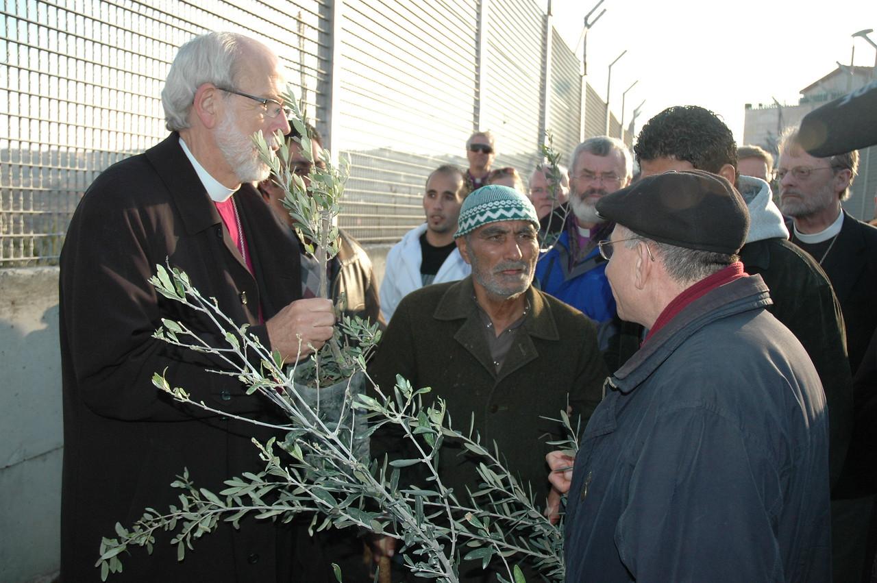 ELCA Presiding Bishop Mark Hanson, left, listens in as ELCJHL Bishop Munib Younan, right, speaks to Sabri Ghrael Abu Sameer at his home in Beddo, West Bank, Jan. 12.