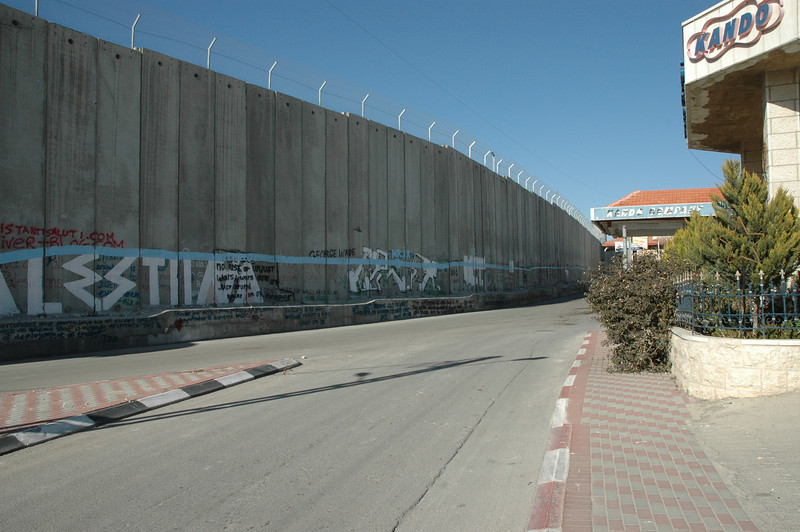 Graffiti is a part of the Israeli separation barrier on the Palestinian side.  This view is from Bethlehem.