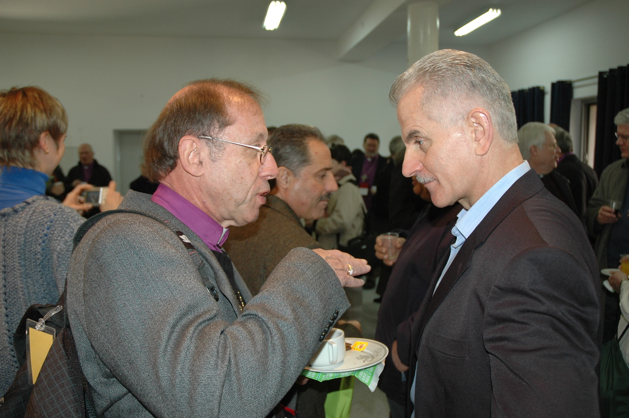 Bishop John Schleicher, ELCA North/West Lower Michigan Synod, speaks with Dr. Charlie Haddad, director, ELCJHL schools, in Ramallah.