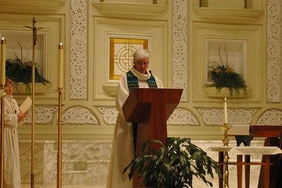 Bishop Sharon Zimmerman Rader, ecumenical officer, the United Methodist Church,  reads a prayers during the Oct. 1 JDDJ celebration in Chicago.