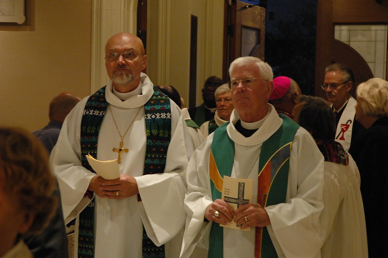 Bishop Wayne Miller, ELCA Metropolitan Chicago Synod, left, and Bishop Allan Bjornberg, ELCA Rocky Mountain Synod, prepare to process at the start of the JDDJ celebration.