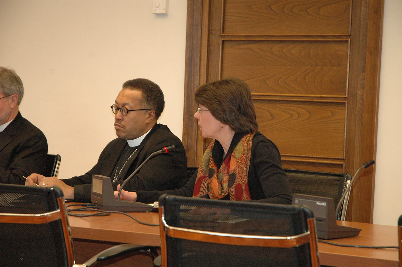 Mitzi Budde, right, Virginia Theological Seminary, Alexandria, addresses Cardinal Kasper Feb. 12 in Rome.  Next to her is Bishop Callon Holloway, ELCA Southern Ohio Synod.