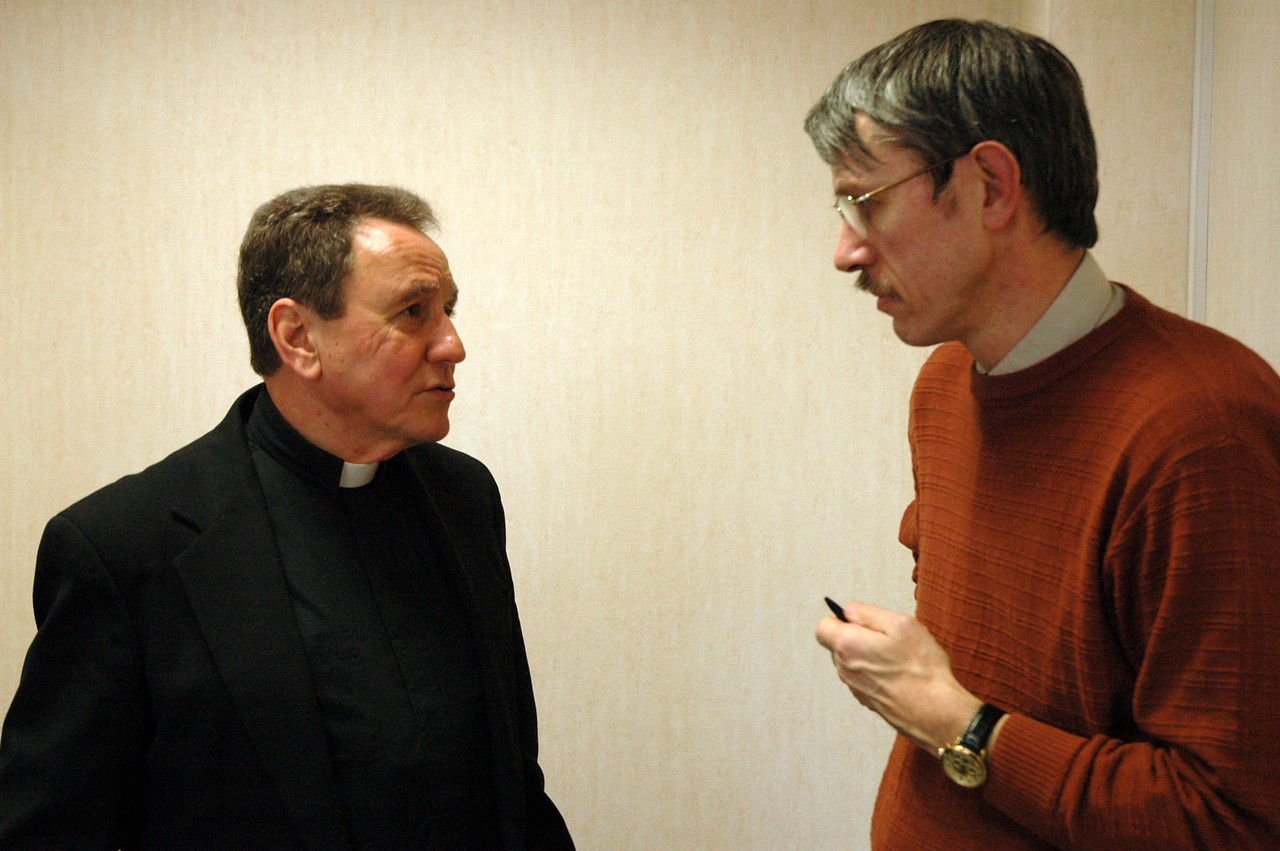Pastor Donald McCoid, executive, ELCA Ecumenical and Inter-Religious Relations, left, speaks with Dr. Martin Davie, The Church of England, during the ELCA delegation's Feb. 5 meeting in London with Church of England officials.