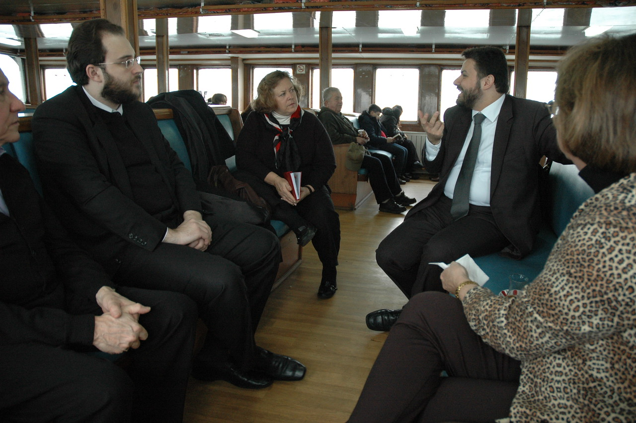 Deacon Joachim Billis, right, Orthodox Ecumenical Patriachate, Istanbul, speaks with the Rev. Susan Langhauser, Olathe, Kan., ELCA Church Council member, during a trip to Halki Island, Turkey, Feb. 7.  At left is Deacon Nephou Tismalis, Ecumenical Patriarchate.