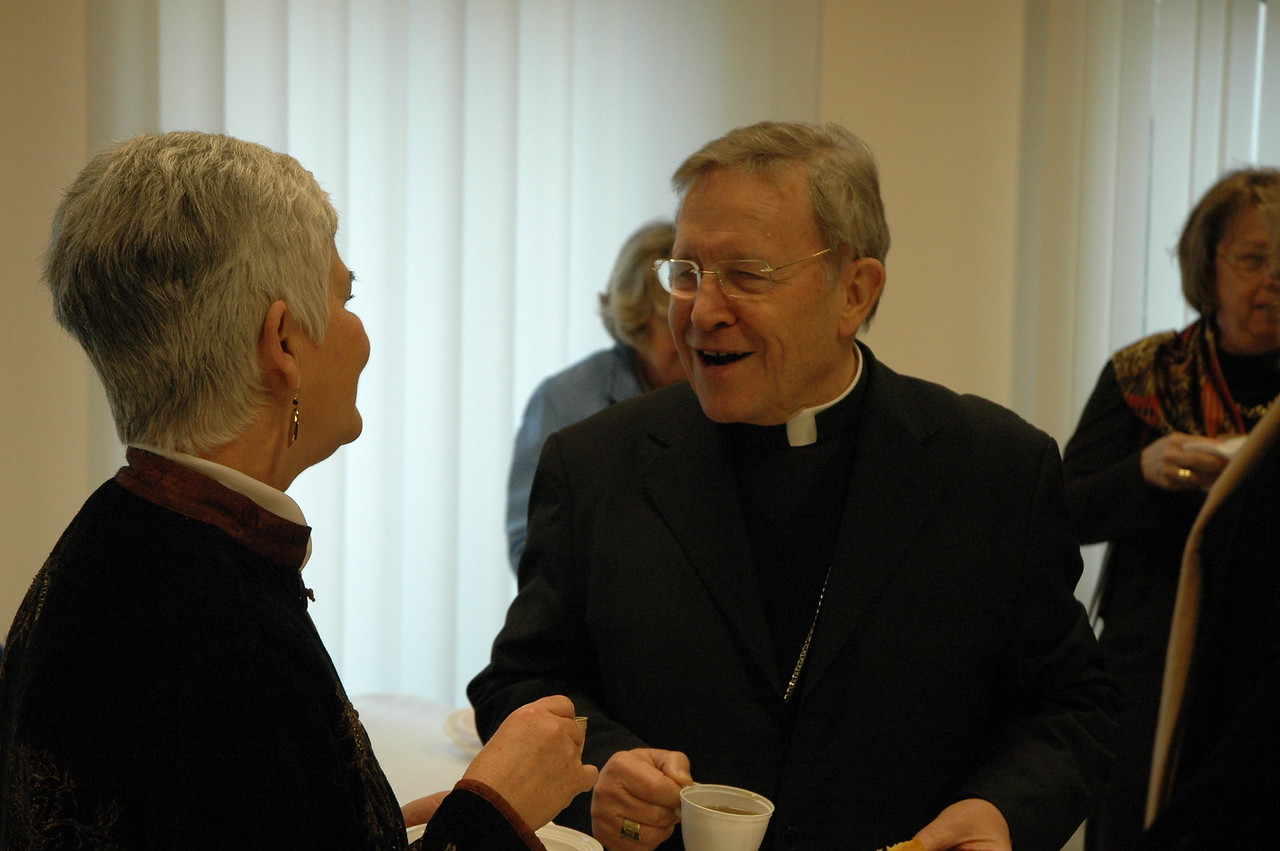 Cardinal Walter Kasper, right, with Ione Hanson, left, during a break in the Feb. 12 meeting in Rome.