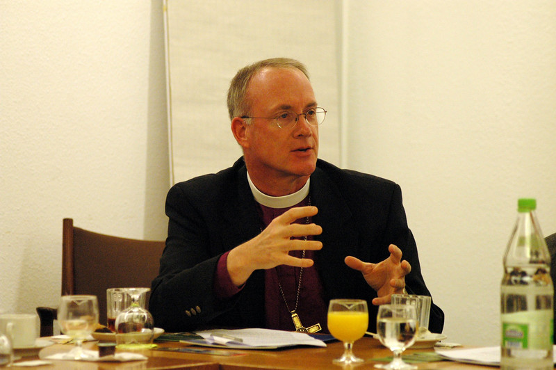 Bishop Michael Burk, ELCA Southeastern Iowa Synod, asks a question during a Feb. 15 meeting of the ELCA delegation and WCC officials in Geneva.