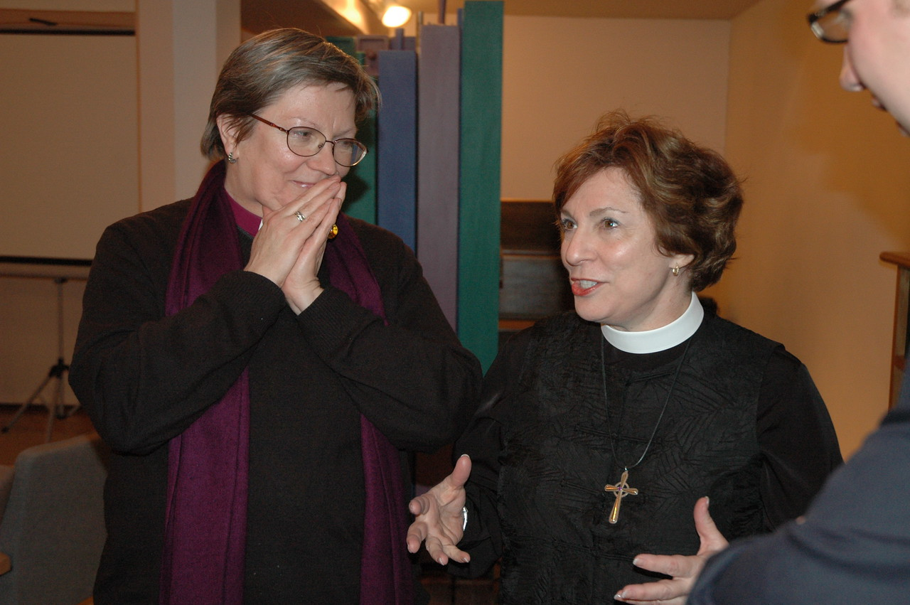 Bishop Jana Jeruma-Grinberga, left, Lutheran Church in Great Britain, listen as Bishop Claire Burkat, ELCA Southeastern Pennsylvania Synod, makes a point.
