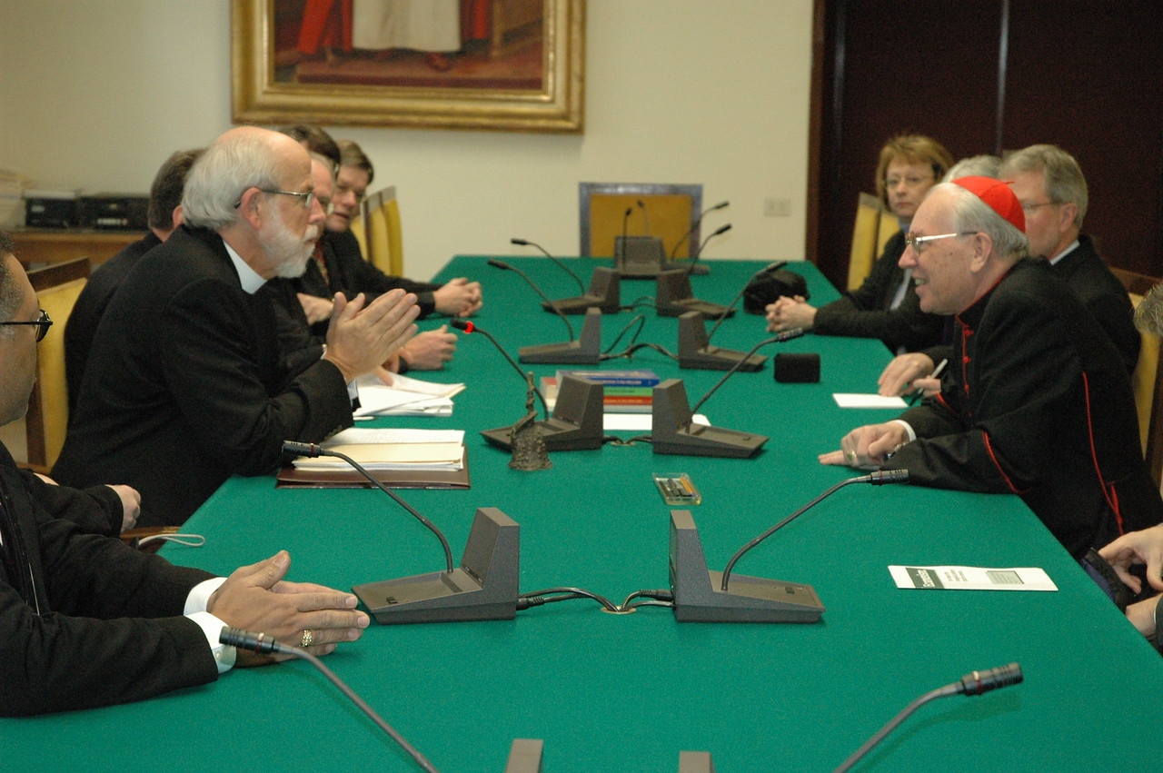 ELCA Presiding Bishop and LWF President Mark Hanson, left, addresses Cardinal Giovanni Re, prefect of The Vatican's Congregation for Bishops, Feb. 13, in Rome.  The two were joined by other members of the ELCA delegation.