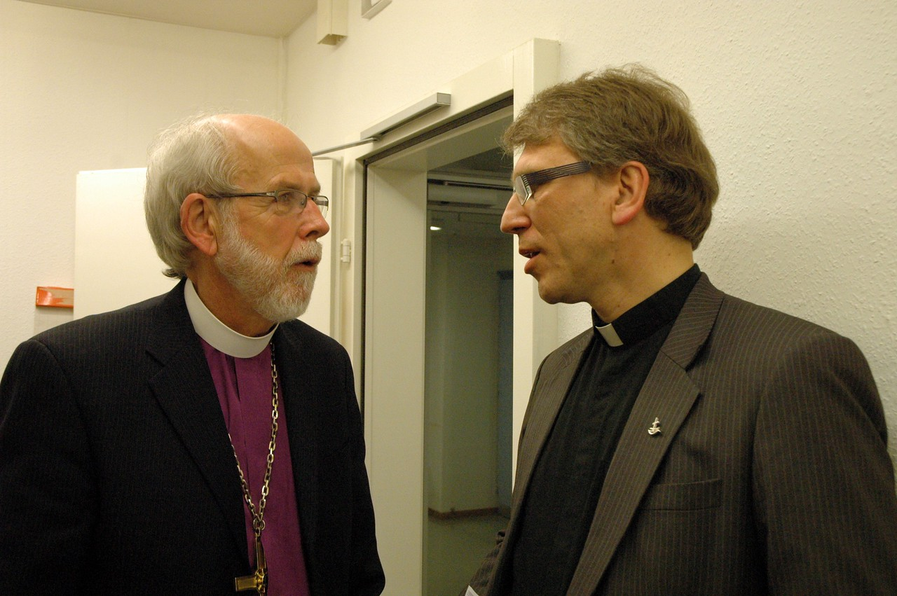 Dr. Olav Fykse Tveit, general secretary, World Council of Churches, right, speaks with ELCA Presiding Bishop and LWF President Mark Hanson Feb. 15 in Geneva.