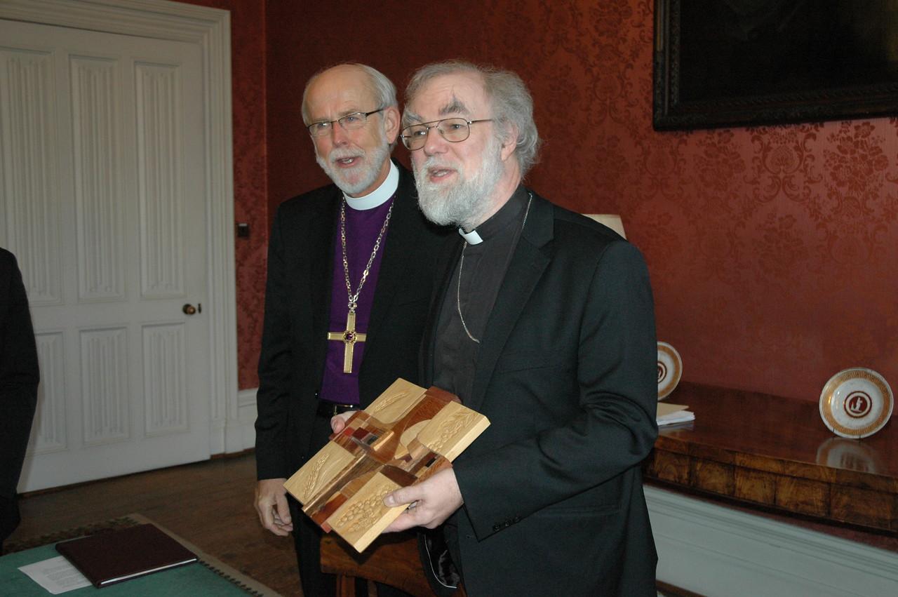 "ELCA Presiding Bishop and LWF President Mark Hanson, left, presents a ""Savior of the World"" cross to the Archbishop of Canterbury, Dr. Rowan Williams."