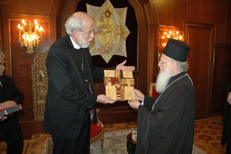 ELCA Presiding Bishop and LWF President Mark Hanson, left, presents a 'Savior of the World' cross to the Ecumenical Patriarch Bartholomew I during a Feb. 8 meeting in Istanbul.