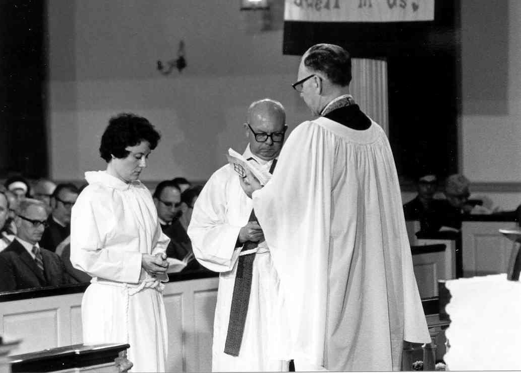 The Rev. Paul M. Orso, right, president of the Maryland Synod, Lutheran Church in America, administers the ordination rite to the Rev. Elizabeth A. Platz, left, at her ordination service at the University of Maryland's Memorial Chapel.
