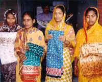 Women display their wares.
