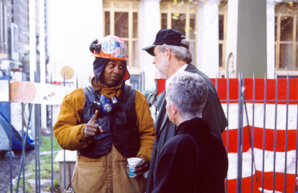 ELCA Presiding Bishop Mark. S. Hanson, center, talks with Eddie, a man who has been working at the New York's World Trade Center site. With them is Bishop Hanson's wife, Ione.