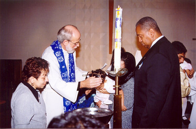 ELCA Presiding Bishop Hanson, second from left, baptized 32 people Dec. 16, at Transfiguration Lutheran Church, Bronx, N.Y., during his visit to the New York.