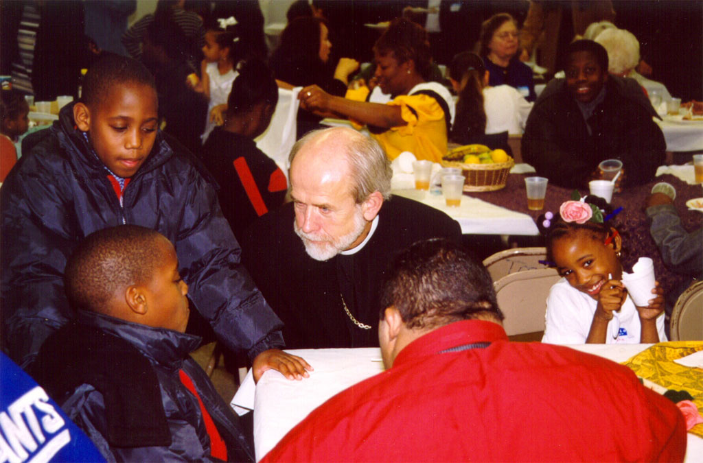 Presiding Bishop Hanson, center, converses with young people at Transfiguration Lutheran Church Dec. 16.