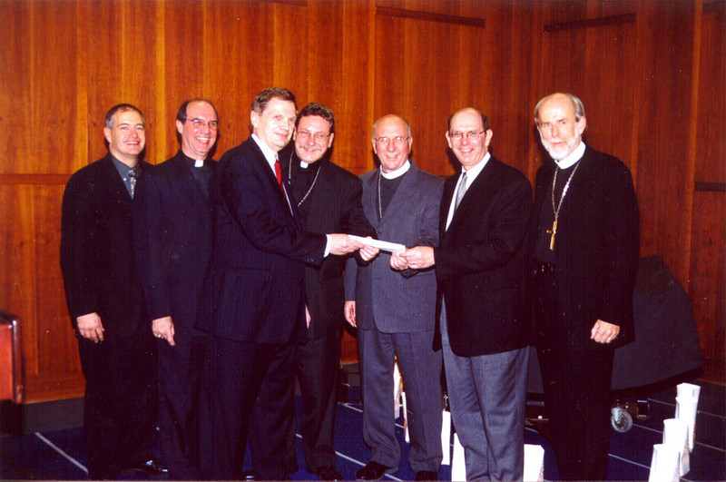 John Gilbert, president and chief executive officer, Aid Association for Lutherans, third from left, and Bruce Nicholson, president and chief executive officer, Lutheran Brotherhood, sixth from left, provided checks from their members and companies to help meet the costs of the Lutheran response effort in New York related to Sept. 11. With them, from left, are John J. Scibilia, Lutheran Disaster Response (LDR), New York; the Rev. Gilbert B. Furst, LDR director; the Rev. Stephen P. Bouman, bishop, ELCA Metropolitan New York Synod; the Rev. David H. Benke, president, LCMS Atlantic District; and ELCA Presiding Bishop Hanson.