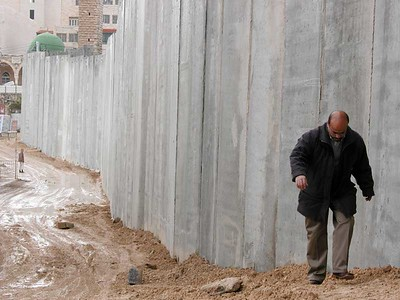 "The ELCA delegation visited the Israeli ""separation"" or ""security"" wall. This section runs through the village of Abu Dis near Jerusalem. The ELCA bishops in the delegation say the wall will only heighten tensions between Israelis and Palestinians."