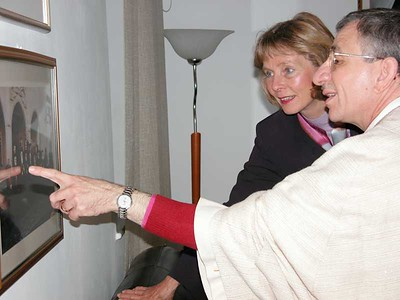 Bishop Munib Younan, right, Evangelical Lutheran Church in Jordan (and Palestine) (ELCJ), and U.S. Rep. Lois Capps (D-Calif.) examine a photo in the of Middle East heads of churches.