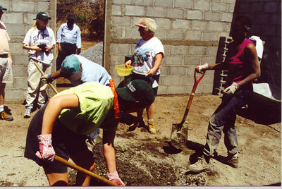 ELCA representatives and others worked to construct new home in Pacora.  Here, they mixed cement and mortar.