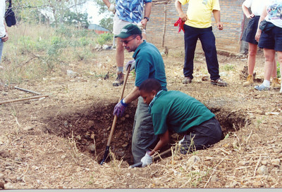 The Rev. Eric C. Shafer, director, ELCA Department for Communication and Tammy Jackson, associate director, ELCA Department for Synodical Relations, dig in a pit in Pacora, Nicaragua.