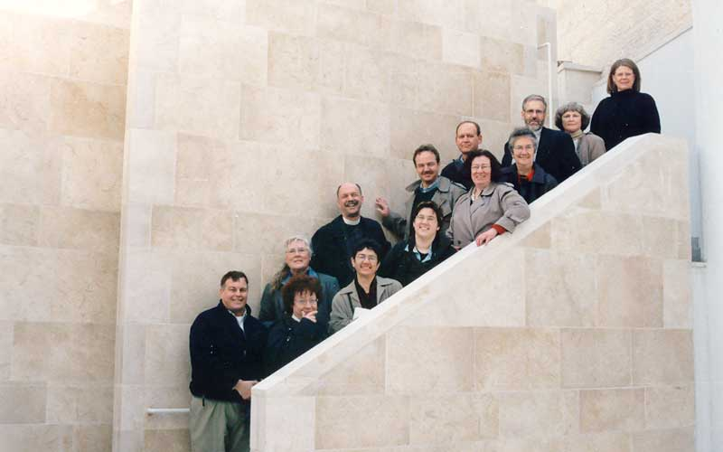 The ELCA communicators gather on the stairs at the International Center at Christmas Lutheran Church, Bethlehem.