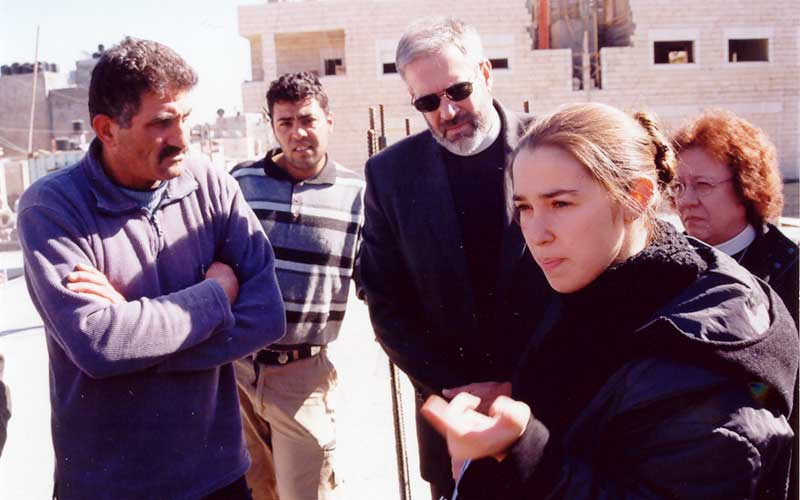 Wael Muhammad Ali, left, describes how his home in the Shu'fat refugee camp was demolished by Israeli authorities. In rear are Mark Holman and Nancy Curtis, and in the right foreground is Tanya Aizikovich from the Israeli Committee Against House Demolition (ICAHD).