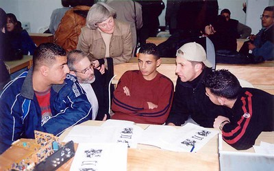 Some students in the telecommunications class at the Lutheran World Federation Vocational Training School, Beit Hanina, Jerusalem, talk with Mark and Marcia Holman.