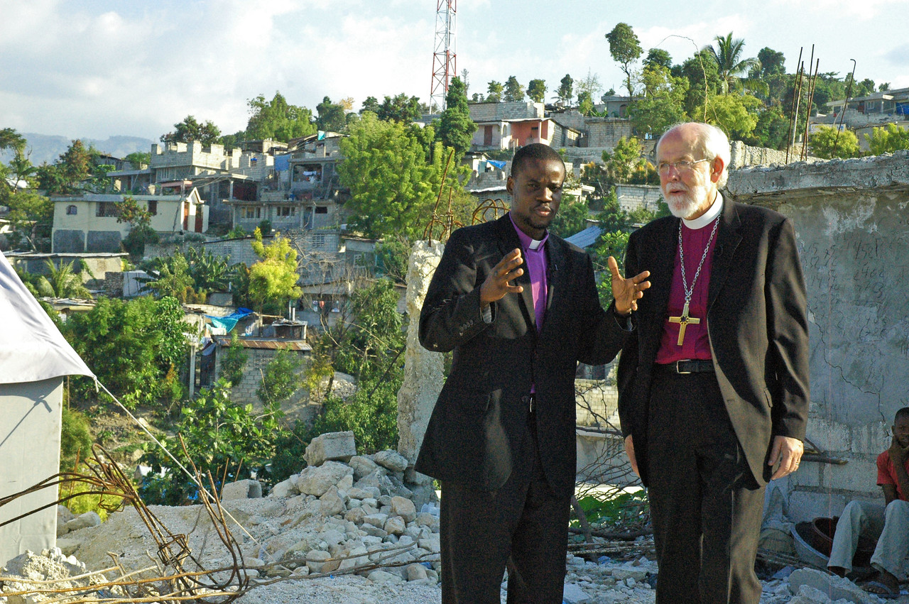 In Sapotille, ELCA Presiding Bishop Mark Hanson walks with Pr. Livenson Lauvanus, leader of the Lutheran church in Haiti, and discusses the church's response to the 2010 earthquake.