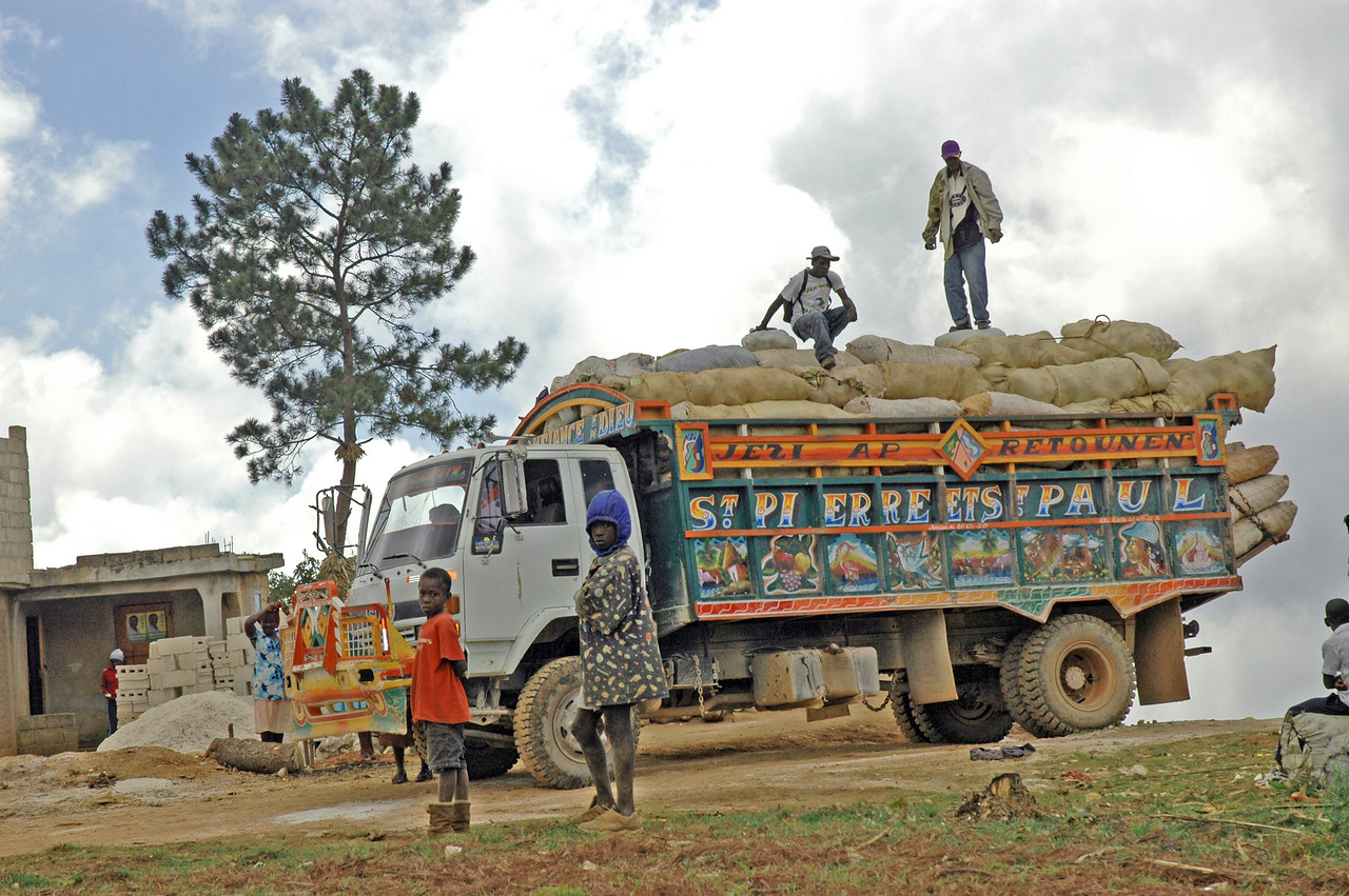 Trucks are loaded with vegetables and head to market for sale.
