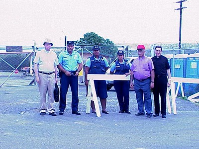 The Rev. H. George Anderson (left), ELCA presiding bishop, the Rev. Donald J. McCoid, bishop of the ELCA Southwestern Pennsylvania Synod, Pittsburgh, and the Rev. Francisco J. Sosa, bishop of the ELCA Caribbean Synod, Dorado, Puerto Rico, stand with three guards at the U.S. Navy's Camp Garcia, Vieques.