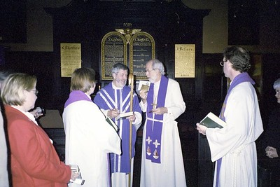 Following a special worship service March 29 with a Lutheran congregation in London, ELCA Presiding Bishop Mark S. Hanson presents a gift to the Rev. Walter Jagucki [center] bishop of the Lutheran Church in Great Britain.