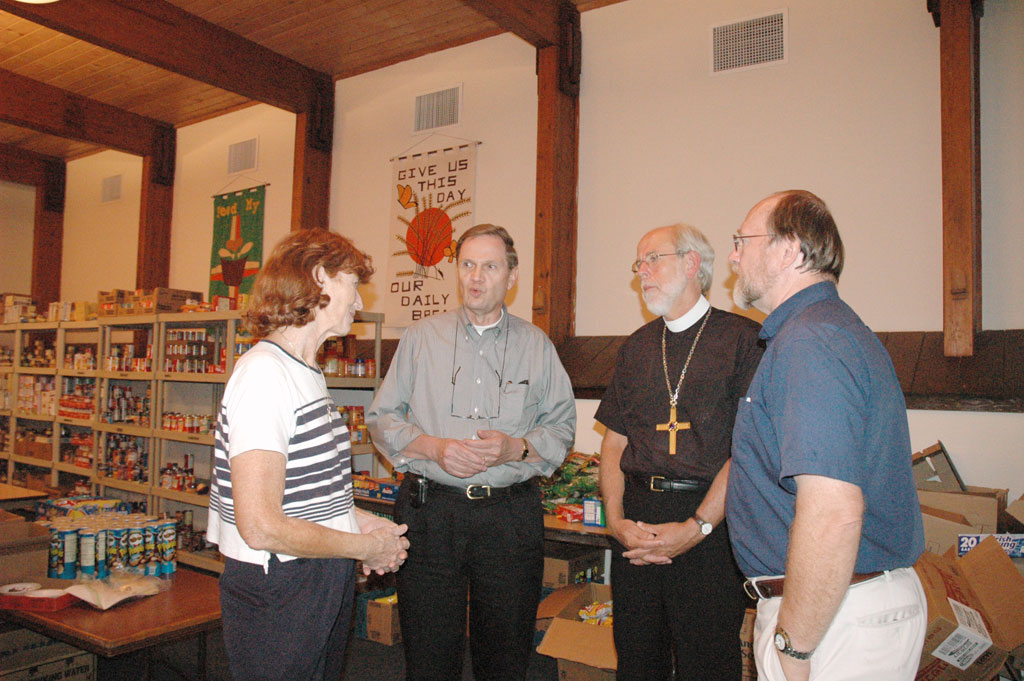 John Gilbert (second from left), former board chair, Thrivent Financial For Lutherans, and the Rev. Mark S. Hanson (second from right), ELCA presiding bishop, meet with the Rev. Gerald D. Bultman, pastor, Bethel Lutheran Church, Biloxi, Miss., and Judy Bultman. Bethel is providing free food, supplies and health care to survivors of Hurricane Katrina.