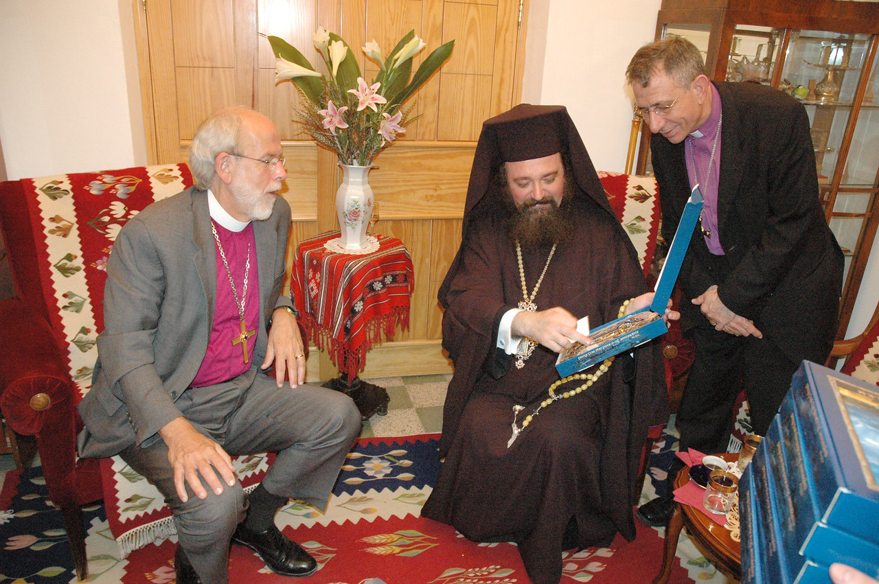 Bishop Mark Hanson, ELCA presiding bishop and LWF president, left, and Bishop Munib Younan, LWF vice president, right, met Sept. 1 with Archimandrite Ieronim Cretu, center, Patriarchal Representative of the Romanian Orthodox Church in Jerusalem.  Archimandrite Cretu is showing the LWF representatives a locally made cross, containing natural elements from the Holy Land which he presented to Hanson and Younan.