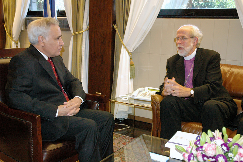 Israeli President Moshe Katsav, left, met with LWF leaders including ELCA Presiding Bishop and LWF President Mark Hanson, right, at Katsav's offices in Jerusalem Sept. 5.   The Lutherans and Katsav discussed prospects for Middle East peace and expressed specific financial concerns about the future of Augusta Victoria Hospital in a 35-minute meeting.