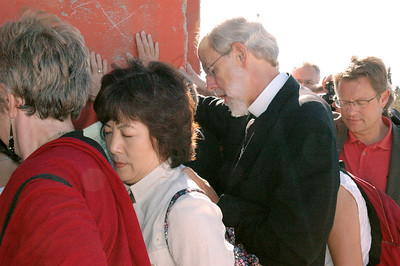 At a Morning Prayer service Sept. 6 in Bethlehem, members of the LWF Council pray at the Israeli separation wall.  Among the participants was ELCA Presiding Bishop and LWF President Mark Hanson.  During the service, council members and staff placed their hands on the wall and prayed for peace, justice and reconciliation between Israelis and Palestinians.