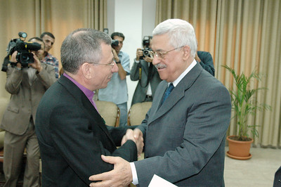 "Palestinian Authority President Mahmoud Abbas, right, presents Bishop Munib Younan, who is also LWF vice president, with the ""Bethlehem 2000"" medal in recognition of  his work for peace, justice and reconciliation, for promoting interfaith relations and for his efforts on behalf of the Palestinian people.  Abbas made the presentation Sept. 3 during a meeting with LWF leaders in Gaza City."