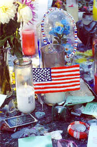 The Union Square memorial includes a number of patriotic symbols, photographs, personal mementos and prayers for those lost in the World Trade Center attacks.