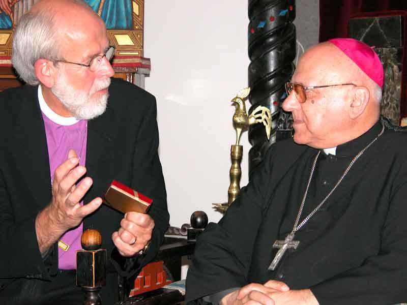 Bishop Hanson presents His Beatitude Michel Sabbah, Latin Catholic Patriarch in Jerusalem, a commemorative medallion displaying the ELCA emblem.