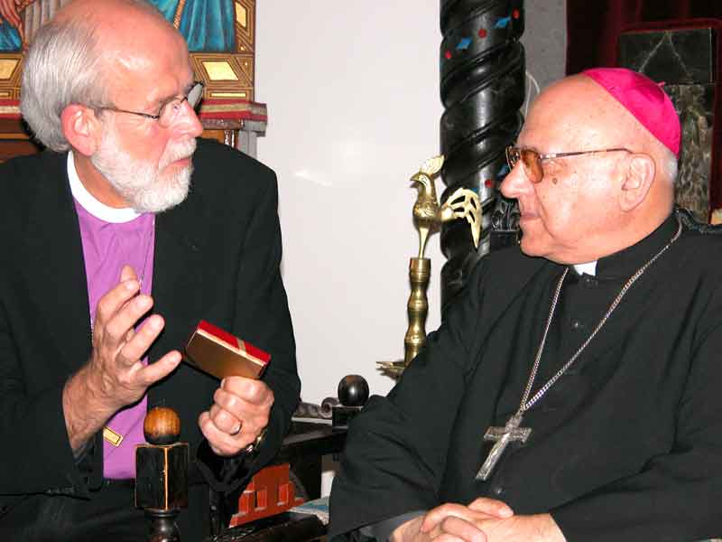 Bishop Hanson presents His Beatitude Michel Sabbah, Latin Catholic Patriarch in Jerusalem, a commemorative medallion displaying the ELCA emblem.