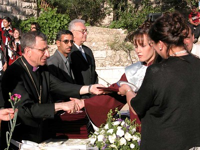 May 23, 2003, was an important day for Shatha Abu Srour, a 12th grade female blind student who graduated with honors from Talitha Kumi School located in the West Bank town of Beit Jala. Born blind, Shatha acquired her primary education at the Helen Keller Center for the visually impaired in Jerusalem and later was mainstreamed in Talitha Kumi School in her hometown. The Lutheran schools are among the first pioneers in advocating and promoting Education for All and Inclusive Education. Shatha will be studying psychology either in the USA or at Bir Zeit University after graduation. Congratulations!