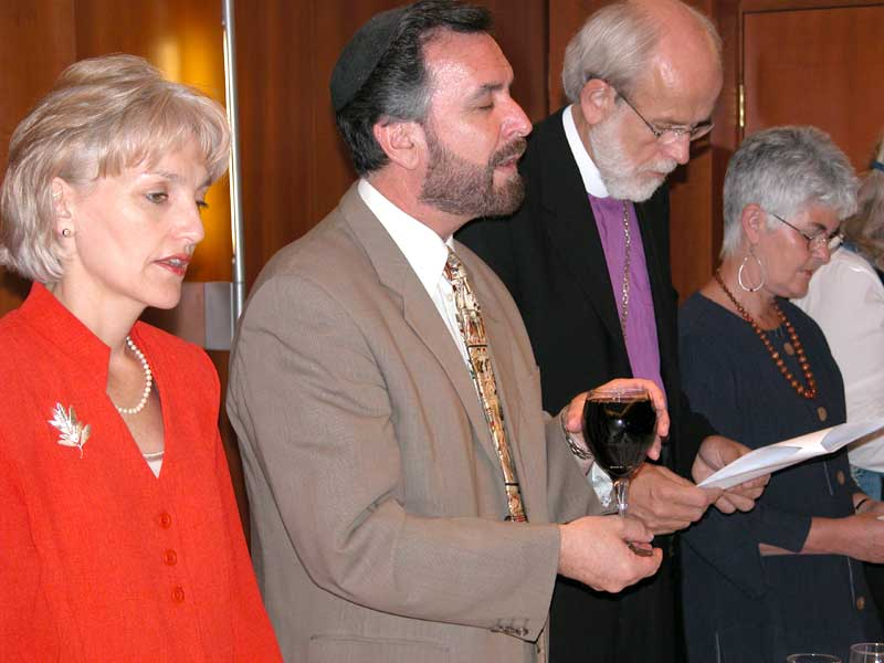 Rabbi David Rosen, international director of interreligious relations for the American Jewish Committee, led the ELCA delegation in song and prayer during a Shabbat Shalom dinner on May 23, 2003, in Jerusalem. Sharon Rosen (left) and Rabbi Rosen hosted the dinner for the Rev. Mark S. Hanson, Presiding Bishop of the Evangelical Lutheran Church in America, his wife, Ione, and the ELCA delegation.