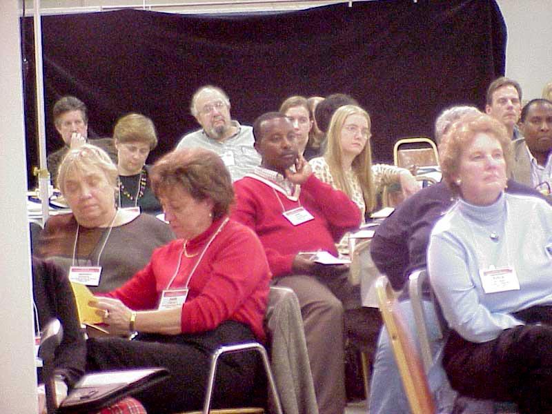 Forum participants listen to a panel discussion.