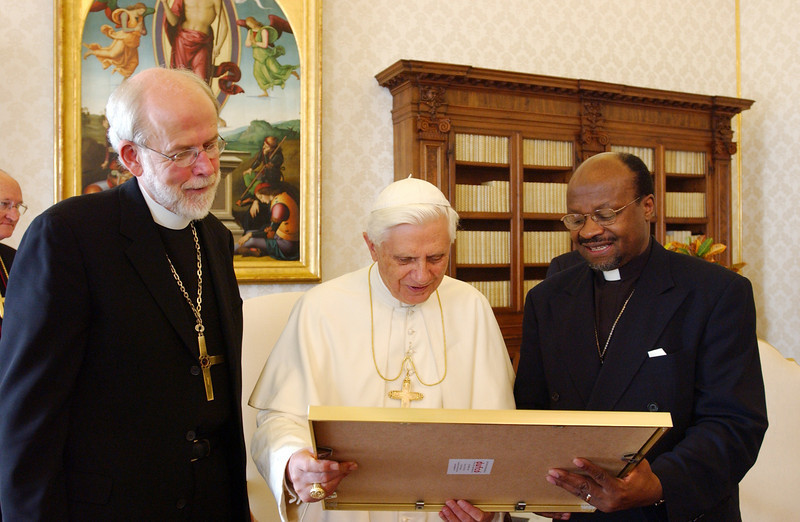 The Rev. Ishmael Noko (right), general secretary, Lutheran World Federation (LWF), Geneva, presented Pope Benedict XVI with a framed copy of the Joint Declaration on the Doctrine of Justification as the Rev. Mark S. Hanson (left), LWF president, Chicago, looked on.  The LWF and Vatican signed the Joint Declaration in 1999.