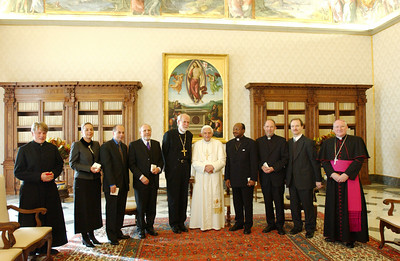 A seven-member delegation of Lutherans met Nov. 7, 2005, with Pope Benedict XVI in the library of his Vatican residence.  The Lutheran delegation was accompanied by Bishop Brian Farrell (right), secretary, Pontifical Council for Promoting Christian Unity (PCPCU), and the Rev. Matthias Türk (left), PCPCU staff relating directly to Lutheran matters.