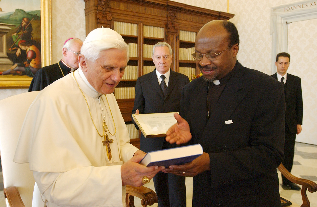 The Rev. Ishmael Noko (right), general secretary, Lutheran World Federation, Geneva, presented Pope Benedict XVI with a German translation of 'From Federation to Communion: The History of the Lutheran World Federation.'