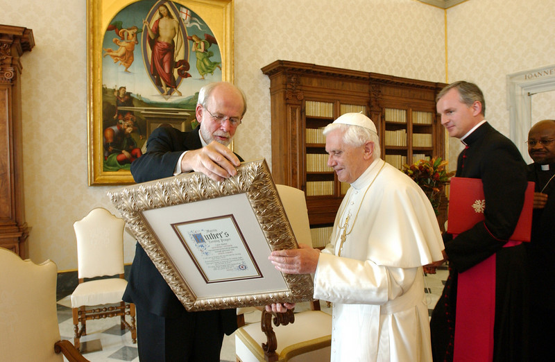 The Rev. Mark S. Hanson (left), president, Lutheran World Federation, Chicago, presented Pope Benedict XVI with a framed copy of Martin Luther's Evening Prayer at the close of a Nov. 7, 2005, audience in the library of the pope's Vatican residence.